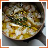 Рыба и морепродукты, тушенные в оливковом масле