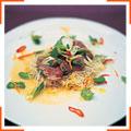 Тунец с цитрусовым соусом, лапшой, травами и чили