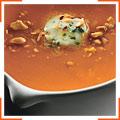 Морковно-имбирный суп с острым маслом и жареным арахисом